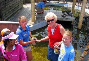 Mom & Kallie petting a baby alligator